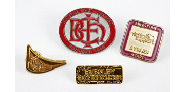 Badge in metallo finitura sabbiata